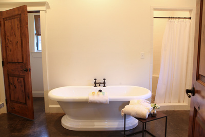 Main Photo Suites- Quad Bathroom with Tub.jpg